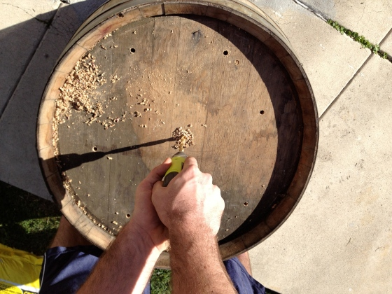 We purchased a gin barrel that actually held wine! mmmmmm the smell :)  Before planting, flip it over and drill holes for water drainage.